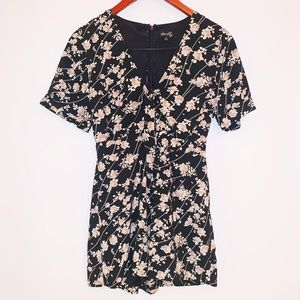 Black floral romper with cutout | Size M